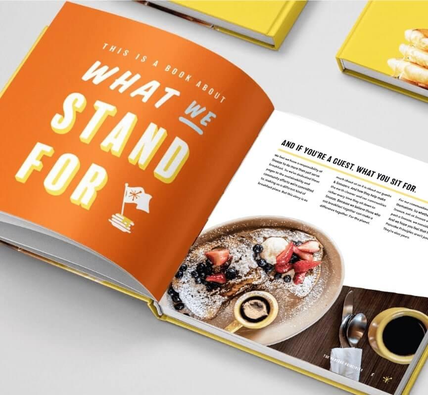 Snooze Breakfast Beliefs Book Open on a White Counter