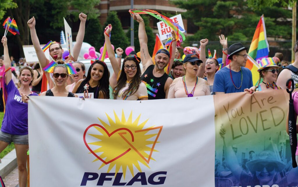 PFLAG National Members Walk in a Prode Parade with a Banner